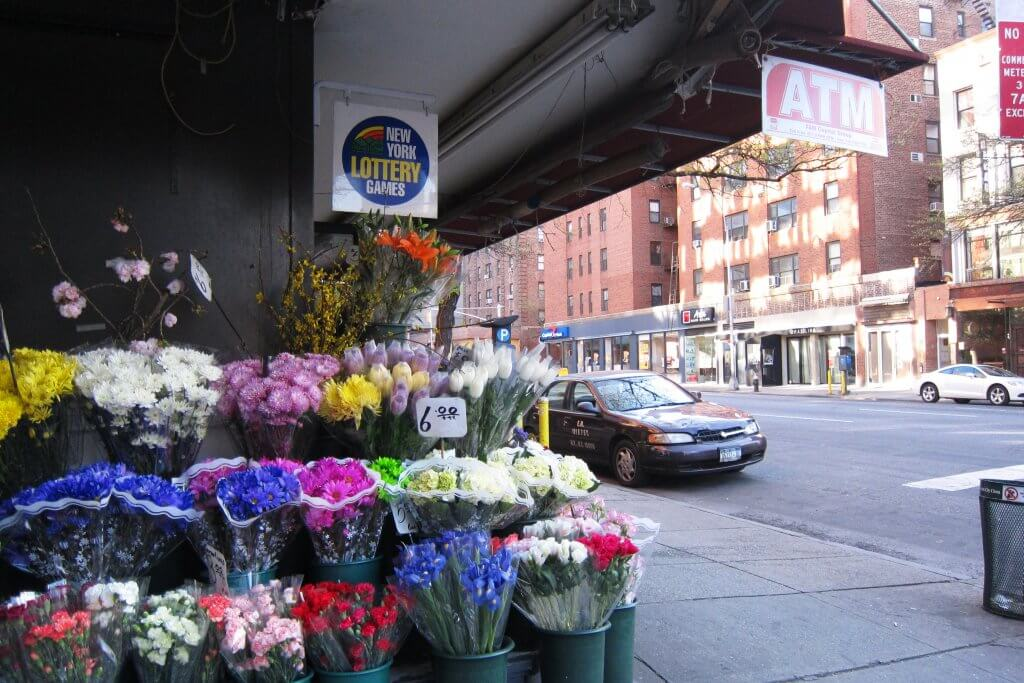 Street Scene showing flowers for sale, NYC