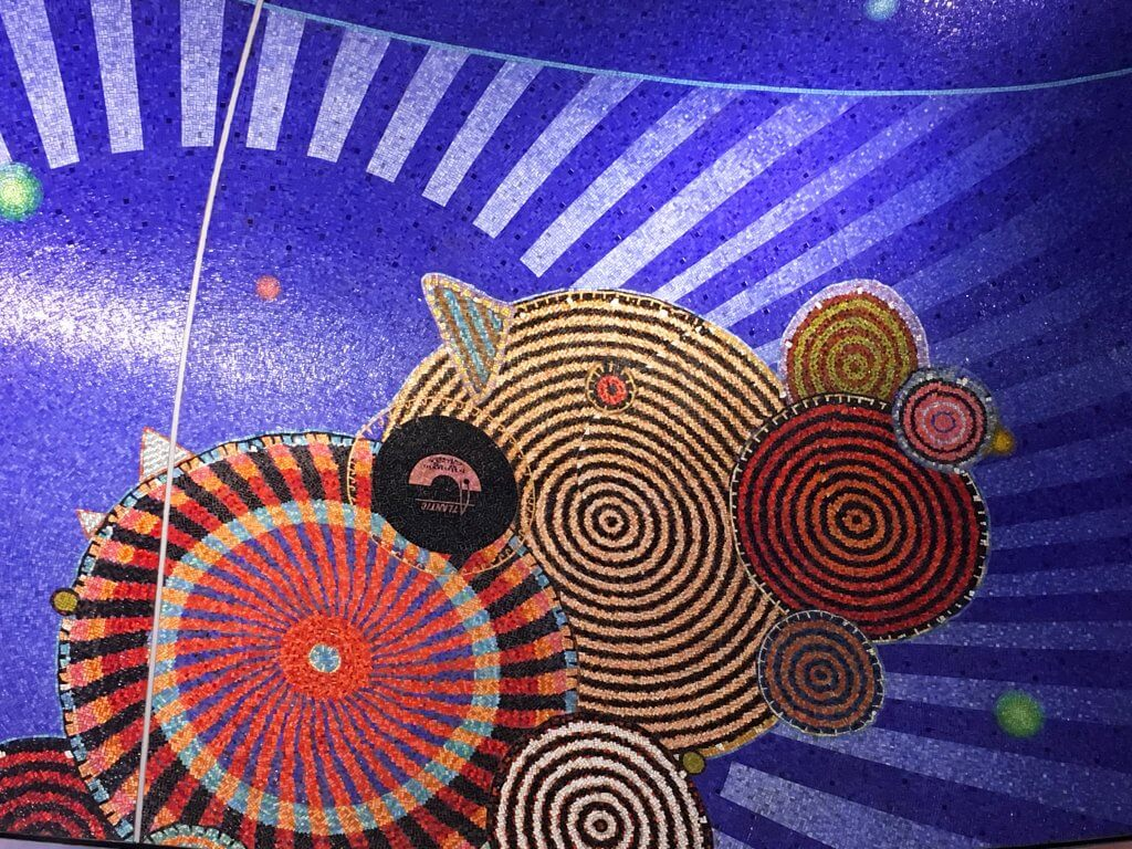 Glittery concentric circles and purple rays; Art in the Subway Station, Hudson Yards, New York City